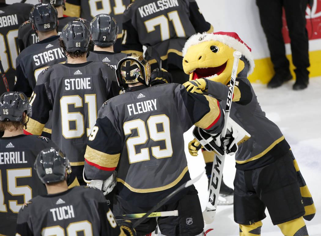 Vegas Golden Knights mascot Chance, right, congratulates Vegas Golden Knights goaltender Marc-A ...