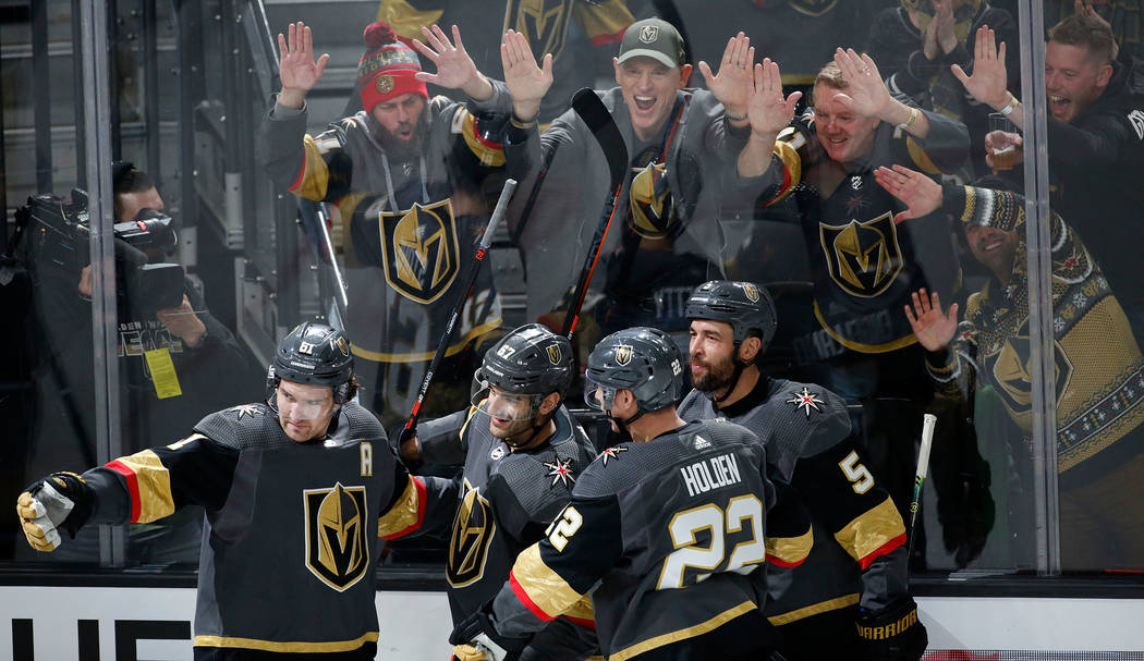 Fans cheer after Vegas Golden Knights left wing Max Pacioretty (67), second from left, scored a ...