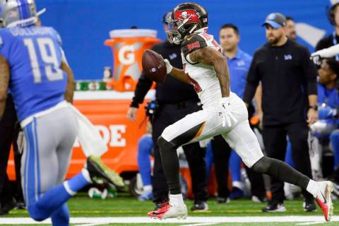 Tampa Bay Buccaneers defensive back Sean Murphy-Bunting returns an interception for a 70-yard t ...