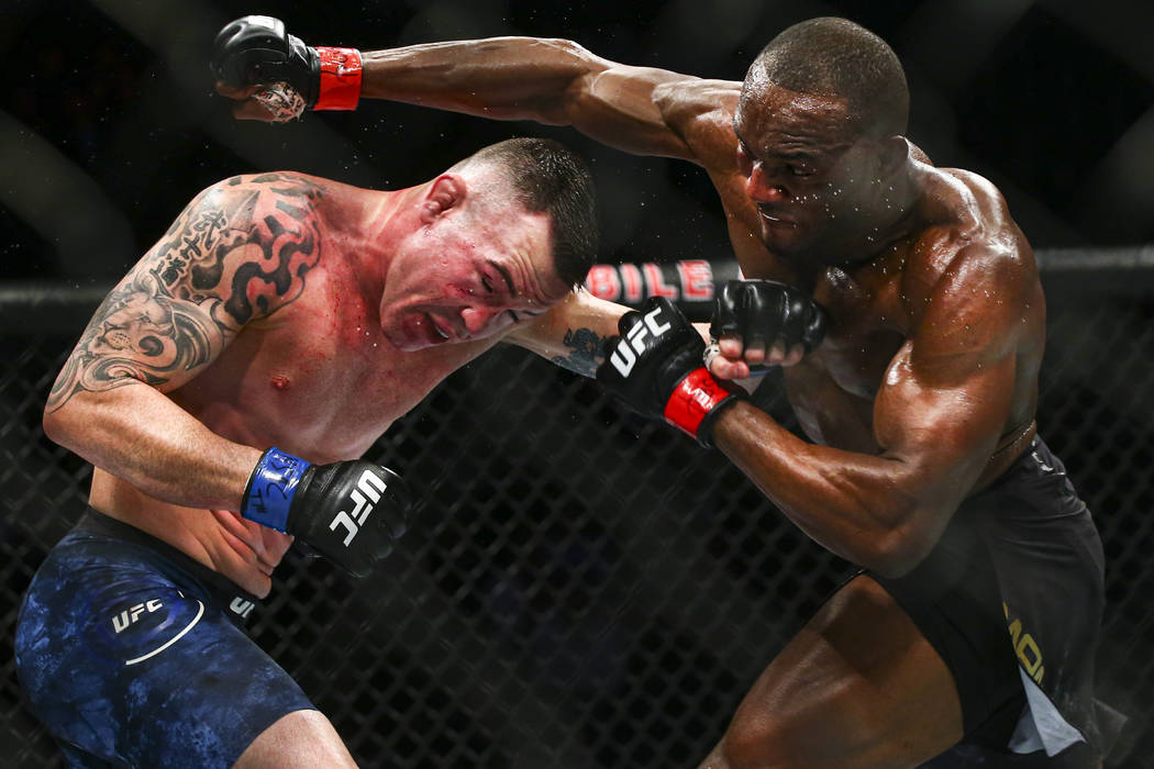 Kamaru Usman, right, fights Colby Covington during their welterweight title boutÊin UFC 24 ...