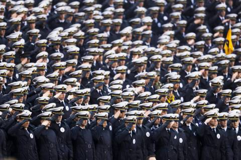 Navy midshipmen salute ahead of an NCAA college football game against Army, Saturday, Dec. 14, ...