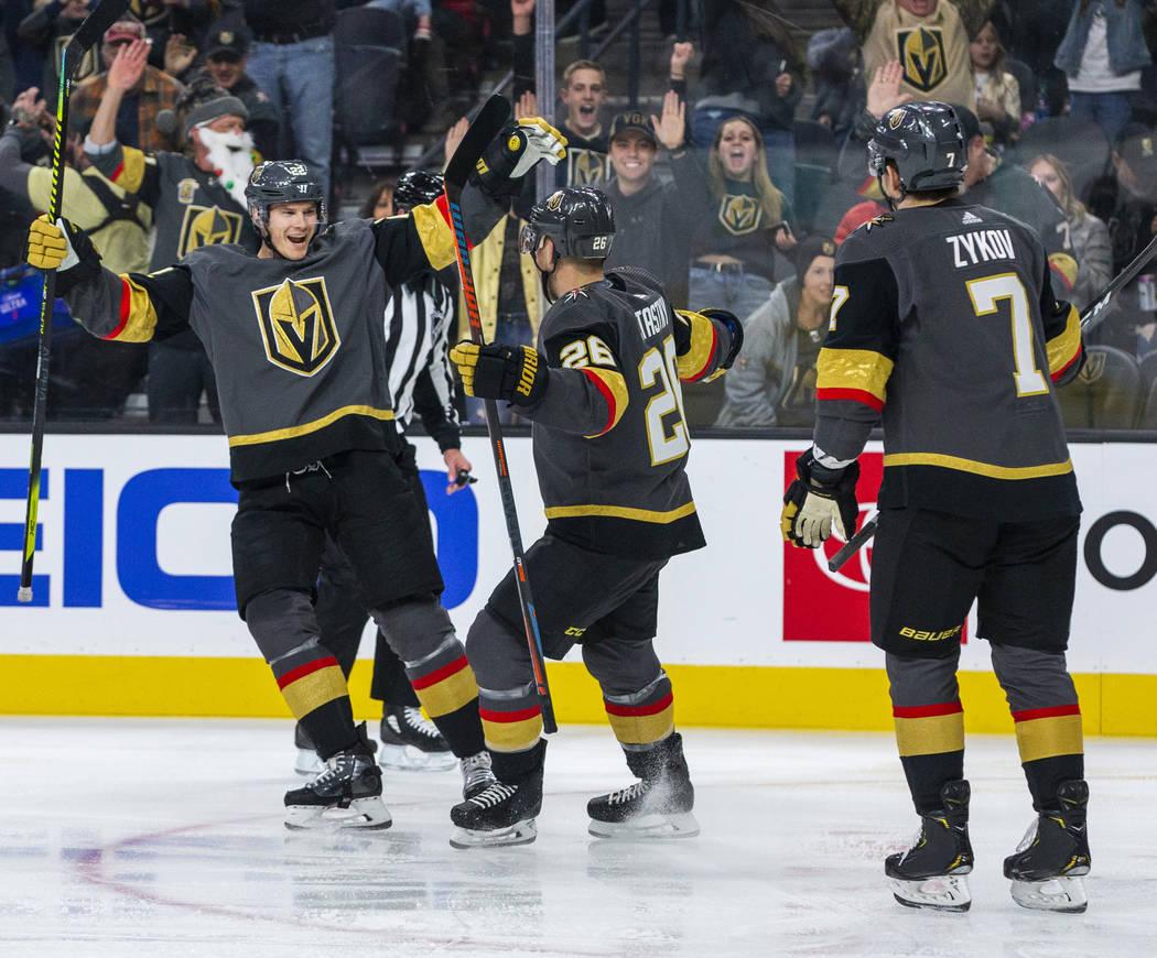 Vegas Golden Knights defenseman Nick Holden (22, left) celebrates a goal with Vegas Golden Knig ...