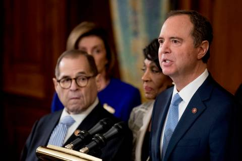 Rep. Adam Schiff, D-Calif., Chairman of the House Intelligence Committee, right, speaks with fr ...