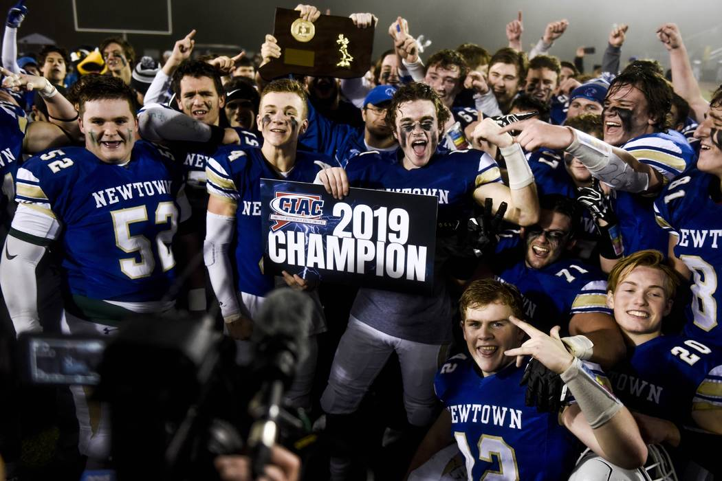 Newtown Nighthawks celebrate their win after beating the Darien Blue Wave in the final play of ...