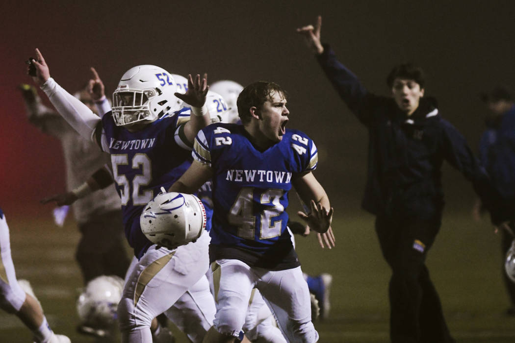 Newtown's Ben Pinto (42) reacts after the Newtown Nighthawks beat the Darien Blue Wave with a w ...
