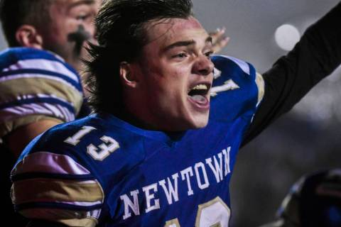 Newtown's Riley Ward (13) reacts and looks back at his teammates after scoring the winning touc ...