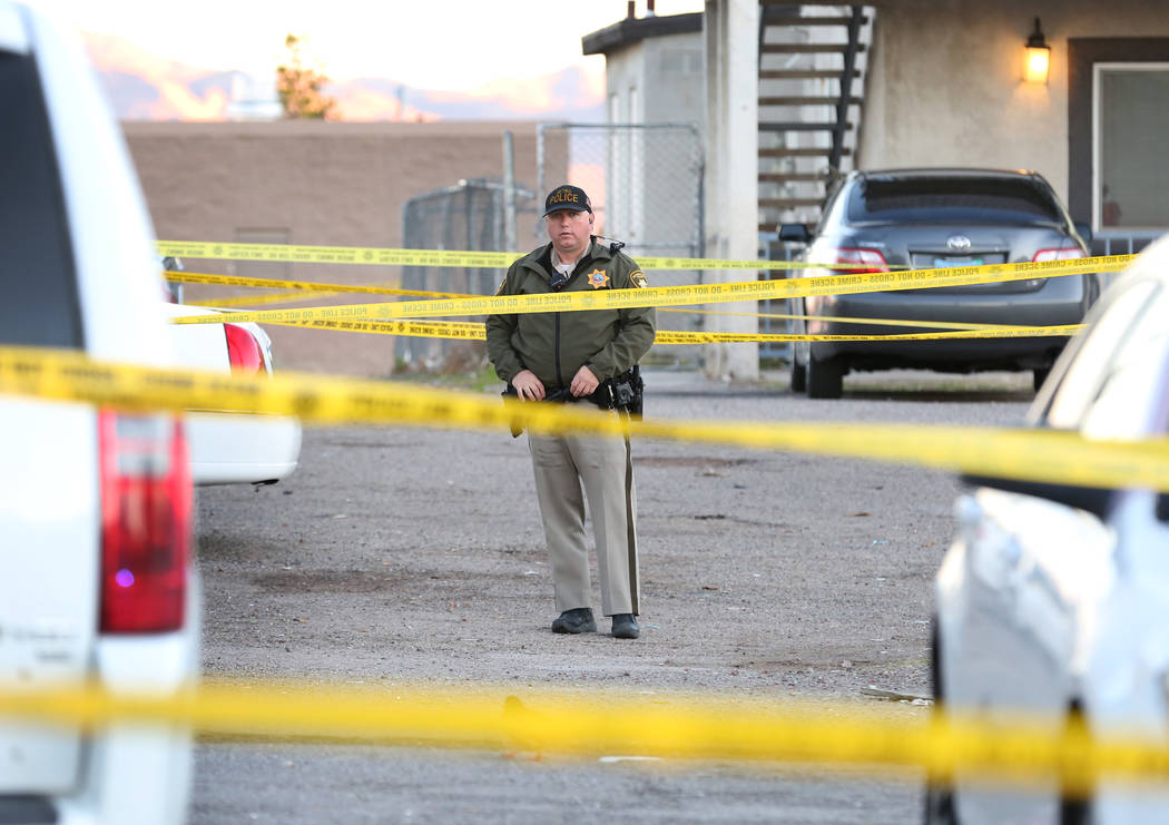 A Metropolitan Police Department officer is seen at the 2300 block of Exeter Drive, near East C ...