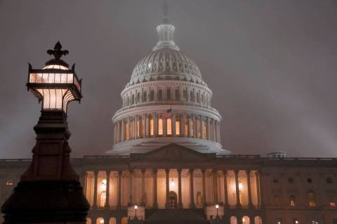 The U.S. Capitol in Washington is shrouded in mist, Friday night, Dec. 13, 2019. This coming w ...