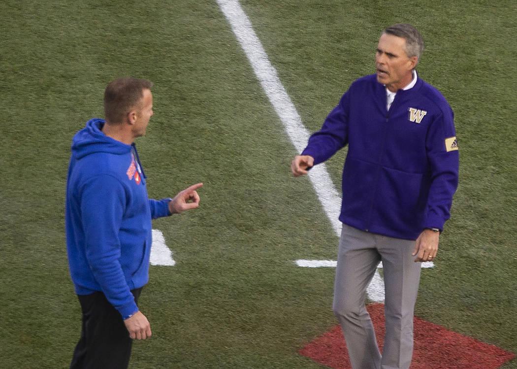 Boise State Broncos head coach Bryan Harsin and Washington Huskies head coach Chris Petersen ch ...