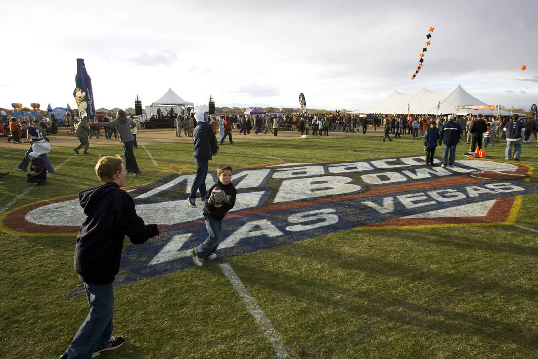 People play in the tailgate section before the MAACO Bowl Las Vegas between Oregon State and Br ...