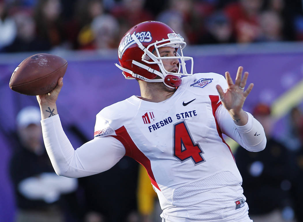 Fresno State quarterback Derek Carr (4) attempts a pass while taking on USC during the Royal Pu ...