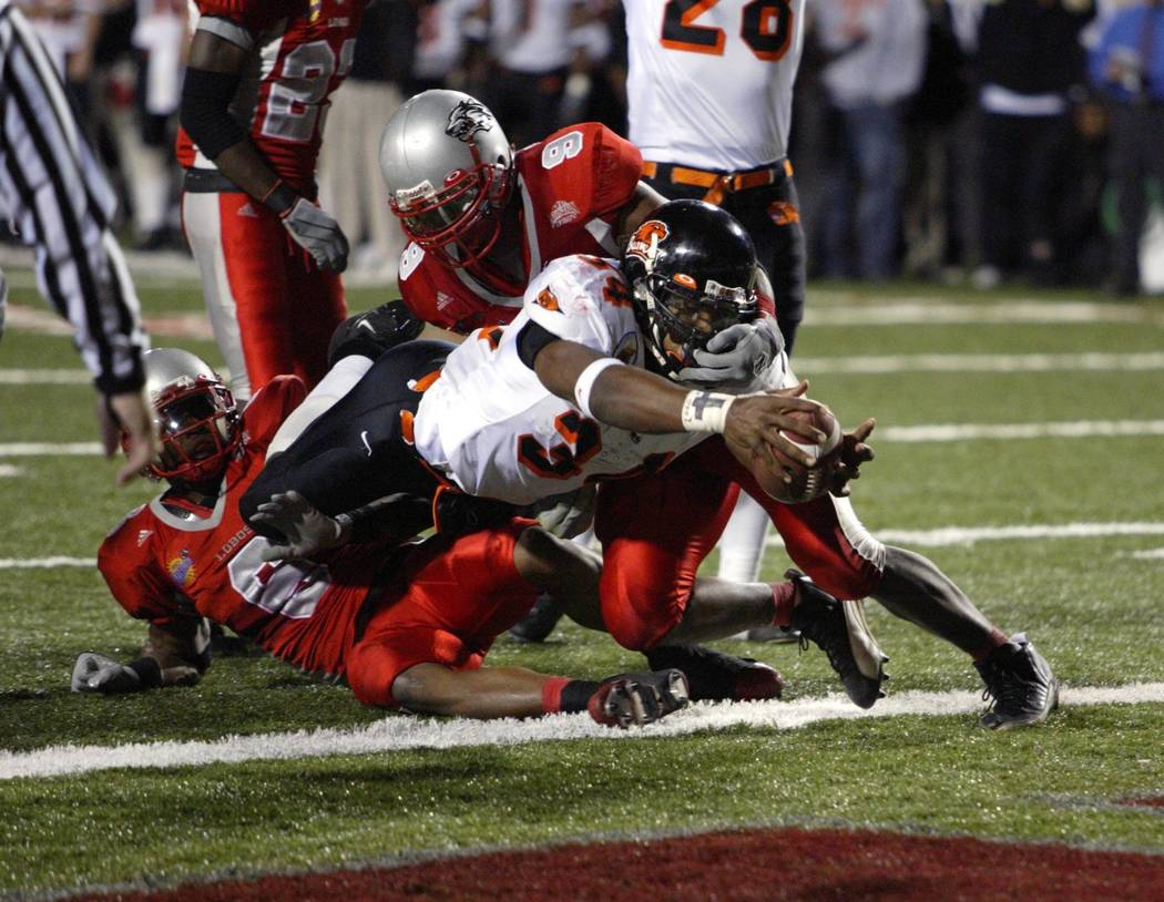 Oregon State tailback Steven Jackson dives for a touchdown in the second quarter as New Mexico ...