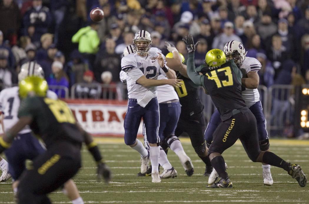 BYU quarterback John Beck throws a pass in the fourth quarter against Oregon in the Las Vegas B ...
