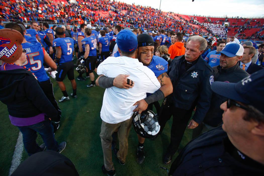 Boise State head coach Chris Petersen hugs player Greg Grimes after defeating Washington 28-26 ...