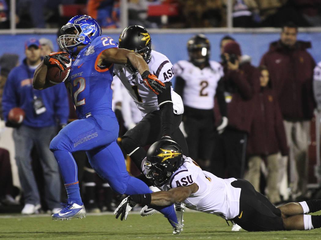 Boise State's Doug Martin (22) tries to outrun Arizona State's Keelan Johnson (10) during the M ...