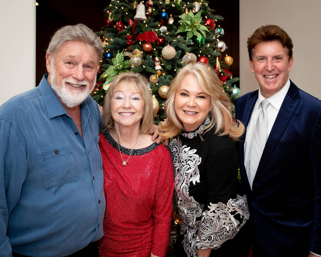 Rich and Claire McDonald, Kristen Routh-Silberman and Richard Luke at holiday party to collect ...