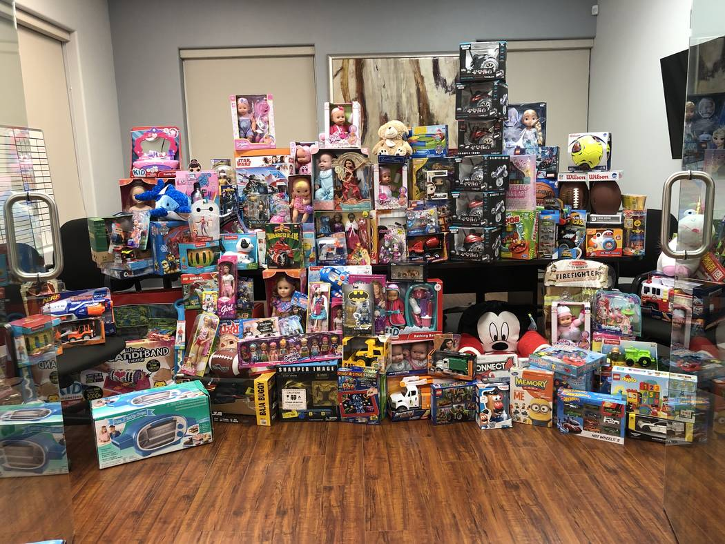 Frank Napoli II led Berkshire Hathaway Home Services' seventh annual toy drive for foster child ...