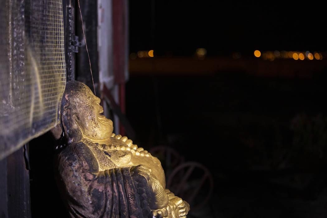 A Buddha statue has burn marks at the Thai Buddhist Temple-Las Vegas,Wat Buddha Pavana,&# ...