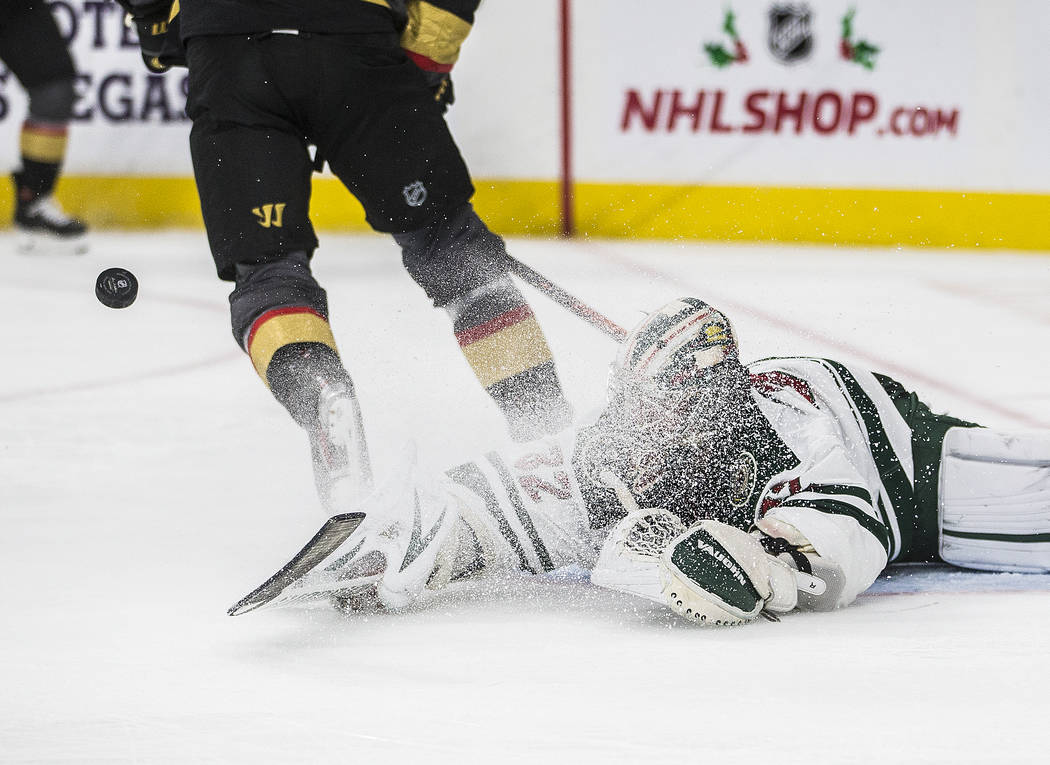 Minnesota Wild goaltender Alex Stalock (32) makes a diving save in the second period of an NHL ...