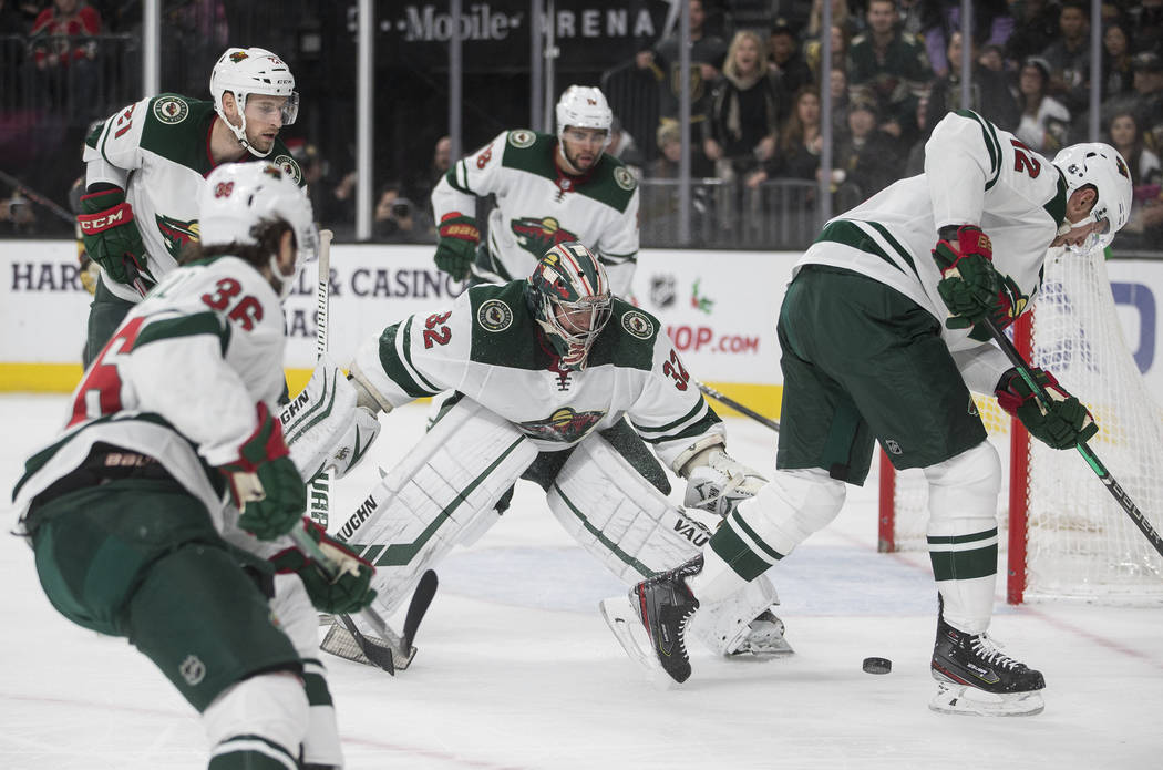 Minnesota Wild goaltender Alex Stalock (32) makes a save in traffic in the second period of an ...