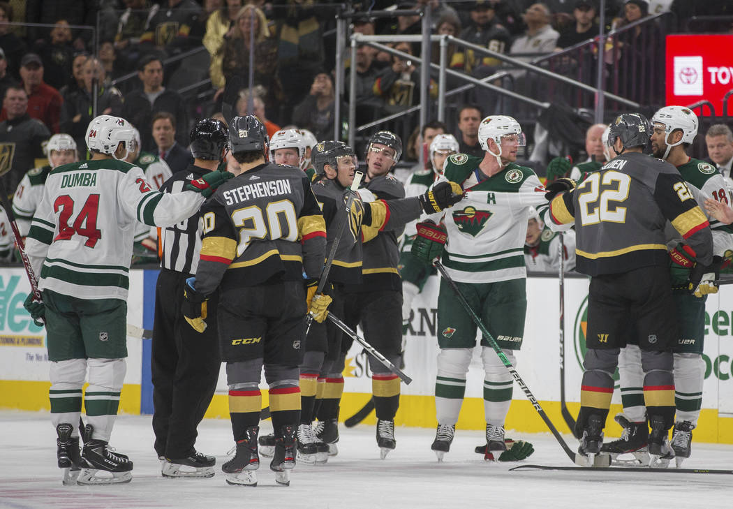Minnesota Wild and Vegas Golden Knights players have to be separated in the second period of an ...