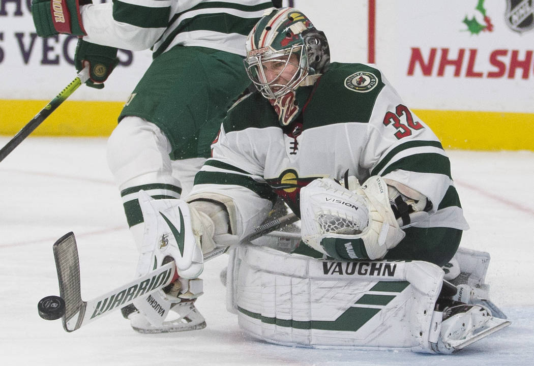 Minnesota Wild goaltender Alex Stalock (32) makes a stick save in the second period of an NHL h ...
