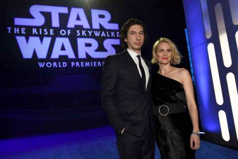 """Adam Driver, left, and Joanne Tucker arrive at the world premiere of """"Star Wars: The Rise ..."""