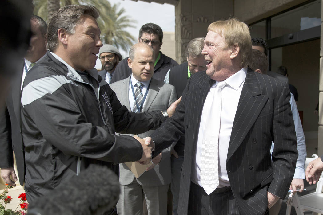 In this March 27, 2017, file photo, Oakland Raiders owner Mark Davis, right, shakes hands with ...