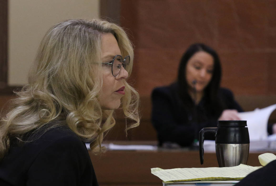 Las Vegas Justice of the Peace Melanie Andress-Tobiasson, left, listens to witness Elizabeth Co ...