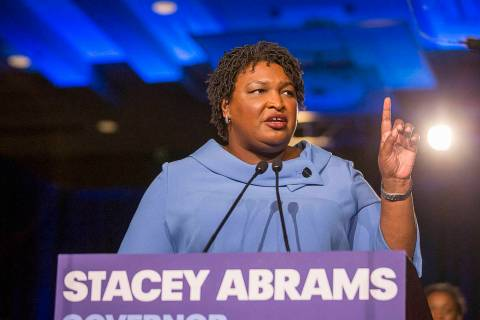 Democratic gubernatorial candidate Stacey Abrams speaks to her supporters during her election n ...