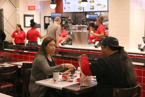 Customers enjoy their meal at the first Chick-fil-A restaurant inside the Golden Nugget on Mond ...