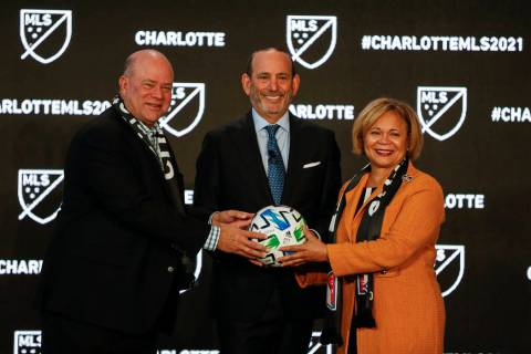Major League Soccer Commissioner Don Garber, left, Charlotte MLS owner David Tepper, center, an ...