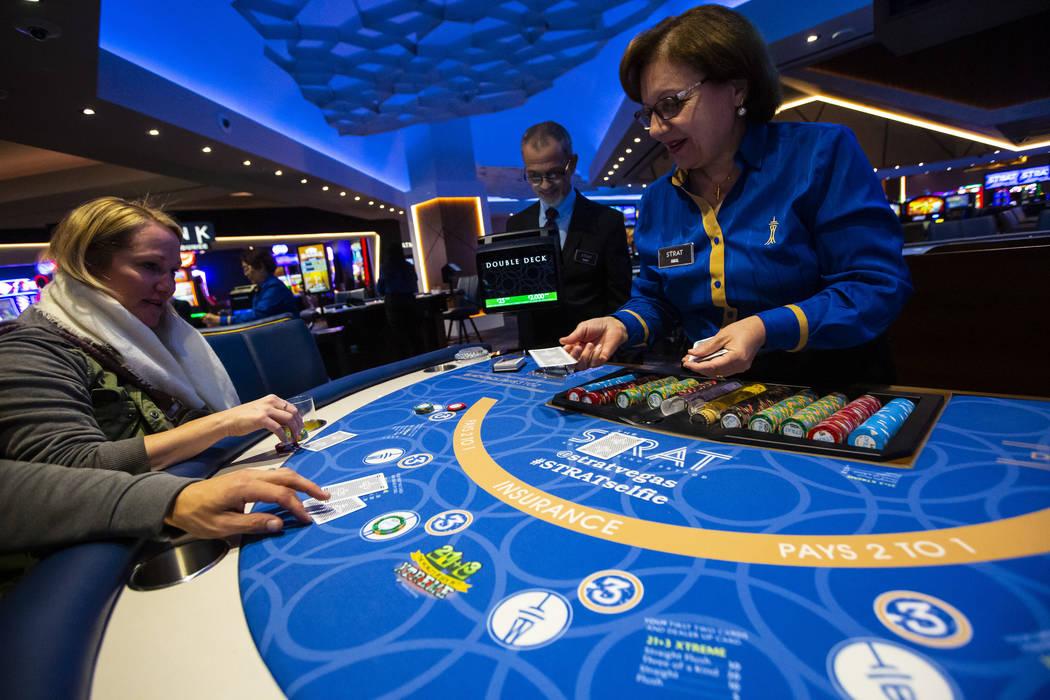 Blackjack dealer Amal Almisber works the table as John and Shannon Welt, of Grants Pass, Ore., ...