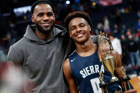 LeBron James, left, poses with his son Bronny after Sierra Canyon beat Akron St. Vincent-St. Ma ...