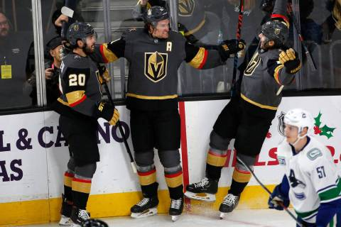 Vegas Golden Knights right wing Mark Stone (61) celebrates with his teammates center Chandler S ...