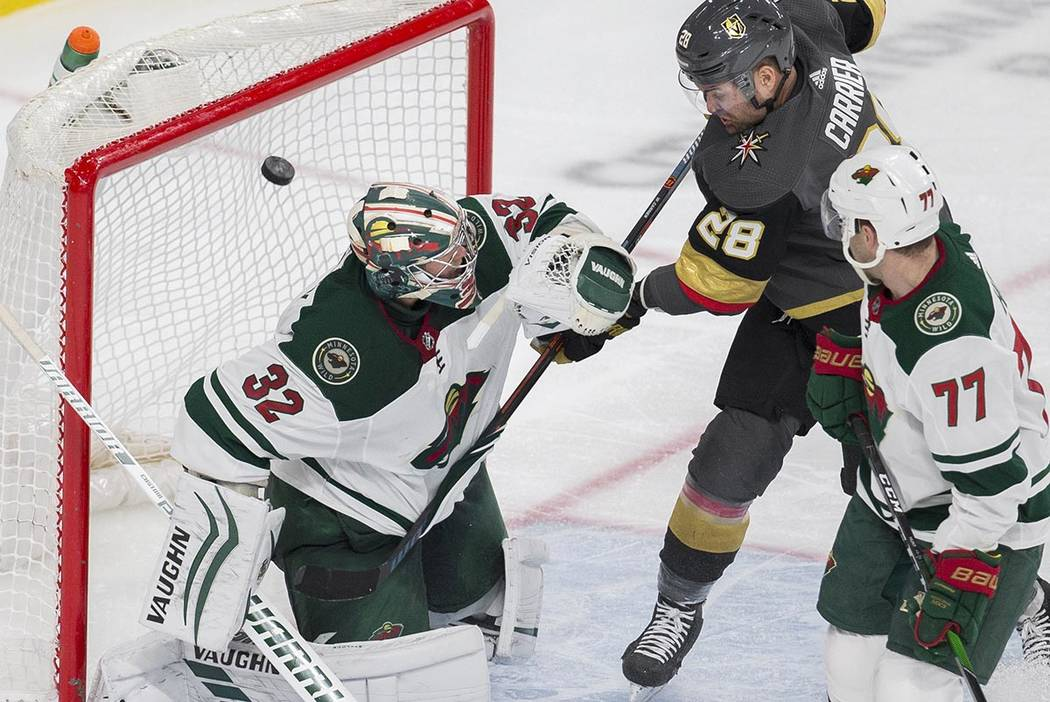Vegas Golden Knights left wing William Carrier (28) assist's on a goal against Minnesota Wild g ...