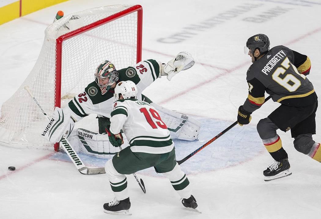 Minnesota Wild goaltender Alex Stalock (32) makes a save against Vegas Golden Knights left wing ...