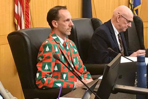 Clark County Commissioner Justin Jones, left, wore a Christmas suit to a Clark County zoning me ...