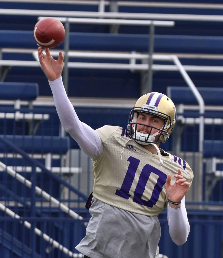 Washington Huskies quarterback Jacob Eason throws a pass during his team practice at Bishop Gor ...