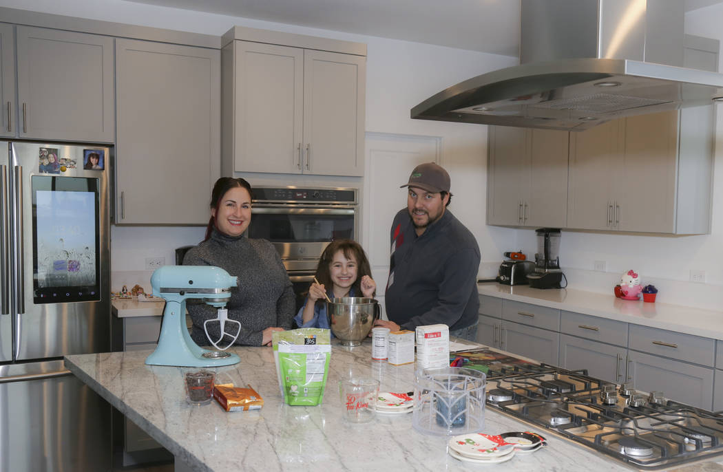 Bonnie D'Amico, her daughter, Mia, and fiancée, Joe Cantino, are in the kitchen of their new ...