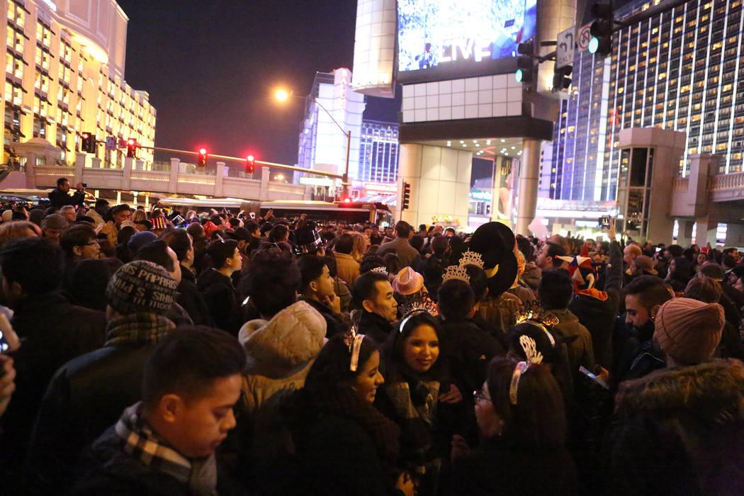 Thousands gather on Las Vegas Boulevard at Flamingo Road awaiting the New Year's Eve fi ...