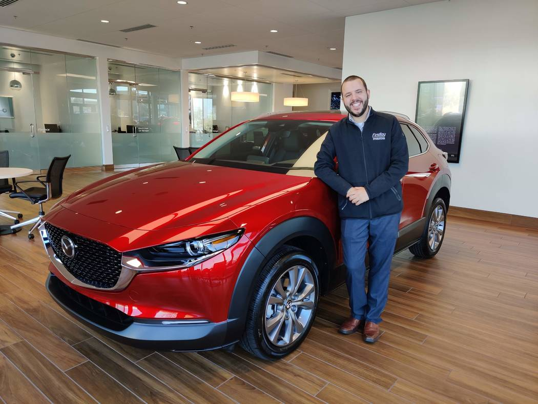 Kevin Lopes, the marketing manager for Findlay Mazda, shows off the 2020 Mazda CX-30 crossover ...