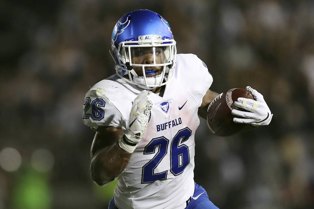 FILE - In this Sept. 7, 2019, file photo, Buffalo running back Jaret Patterson (26) carries the ...