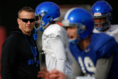 Boise State head coach Bryan Harsin, left, is seen during football practice in Las Vegas, Wedne ...