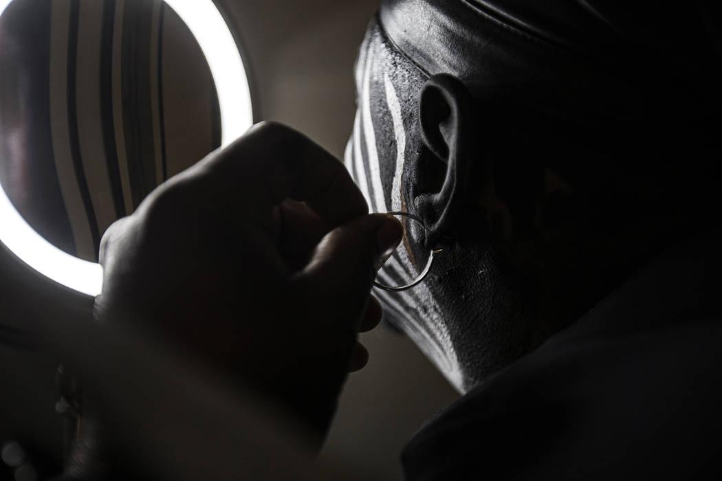 "Raiders super fan Wayne Mabry, known as ""Violator,"" puts his trademark earring in at ..."