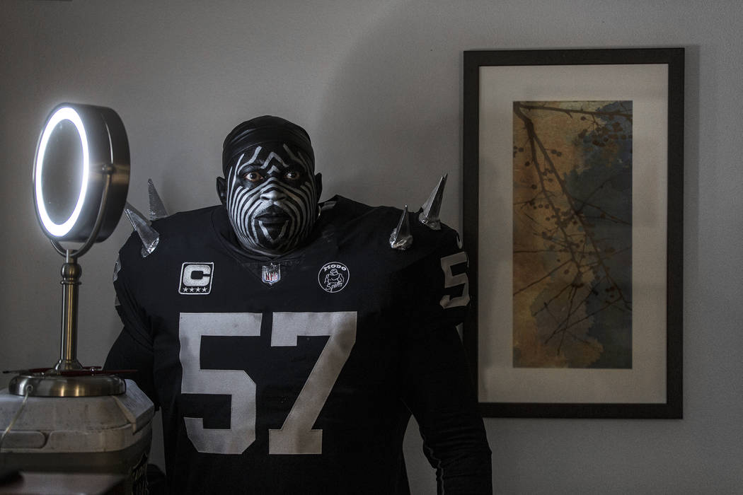 """Raiders super fan Wayne Mabry, known as """"Violator,"""" takes a moment to reflect in his ..."""