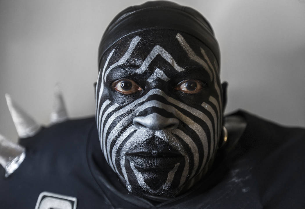 """Raiders super fan Wayne Mabry, known as """"Violator,"""" in his hotel room at 4 a.m. in Du ..."""