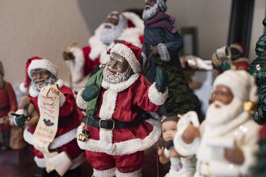 Santa Claus figurines at the home of Roxanne Givens in Las Vegas, Wednesday, Dec. 18, 2019. Giv ...