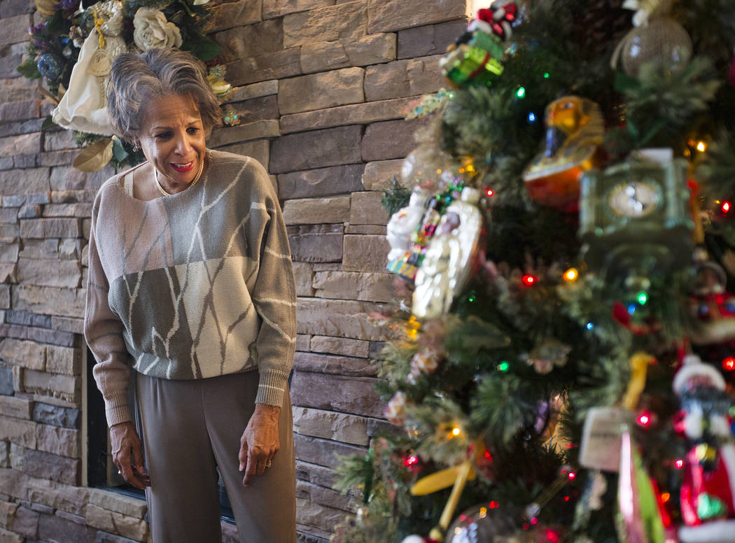 Roxanne Givens looks over her Christmas tree at her home in Las Vegas, Wednesday, Dec. 18, 2019 ...