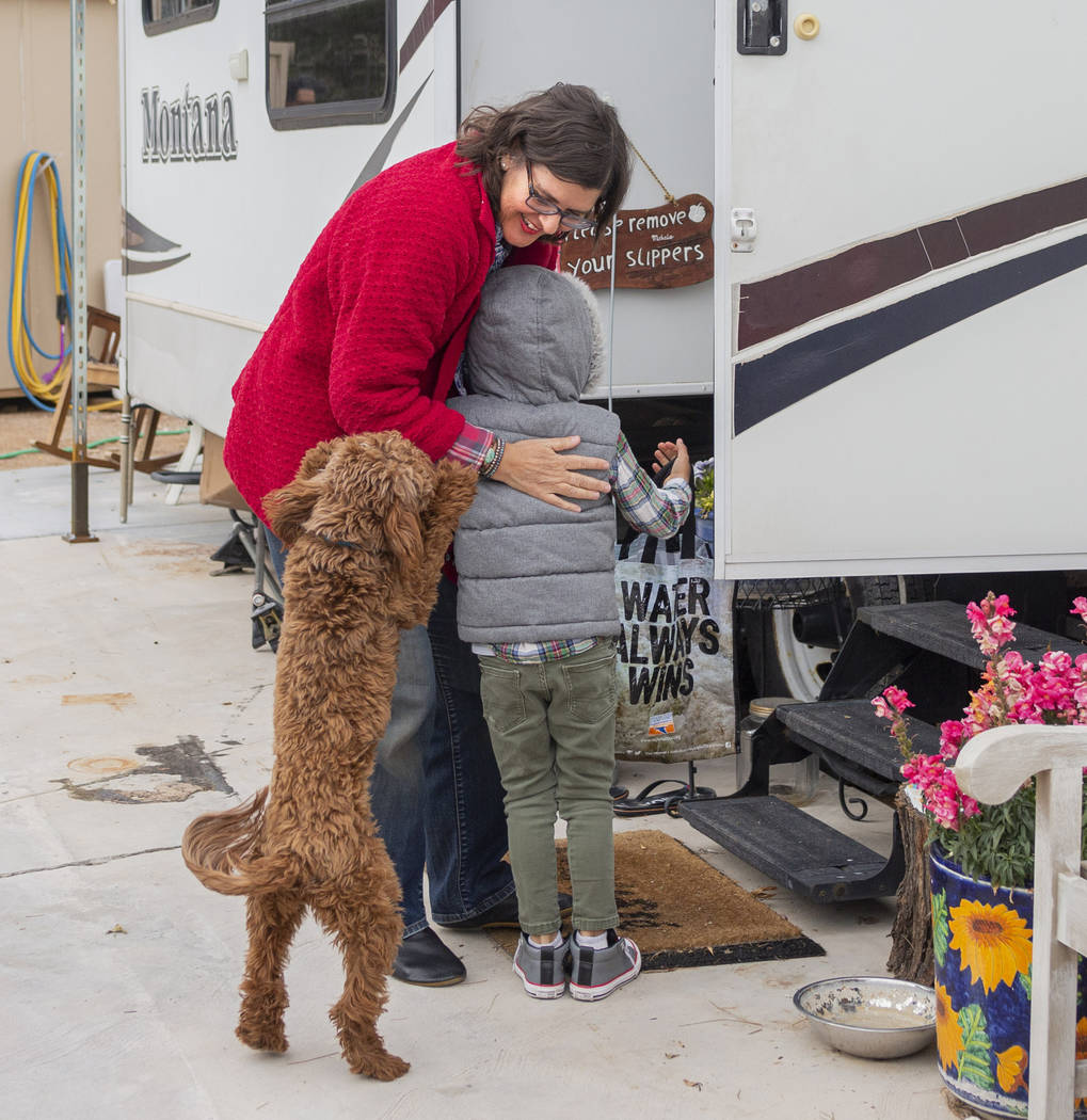 Lisa Bernauer greets her previous student Olamide Ajayi, 6, at Bernauer's home in Las Vegas on ...
